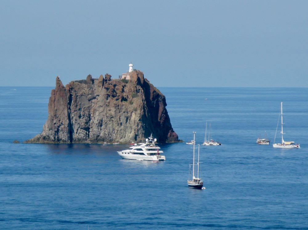 Strombolicchio Lighthouse and Boats