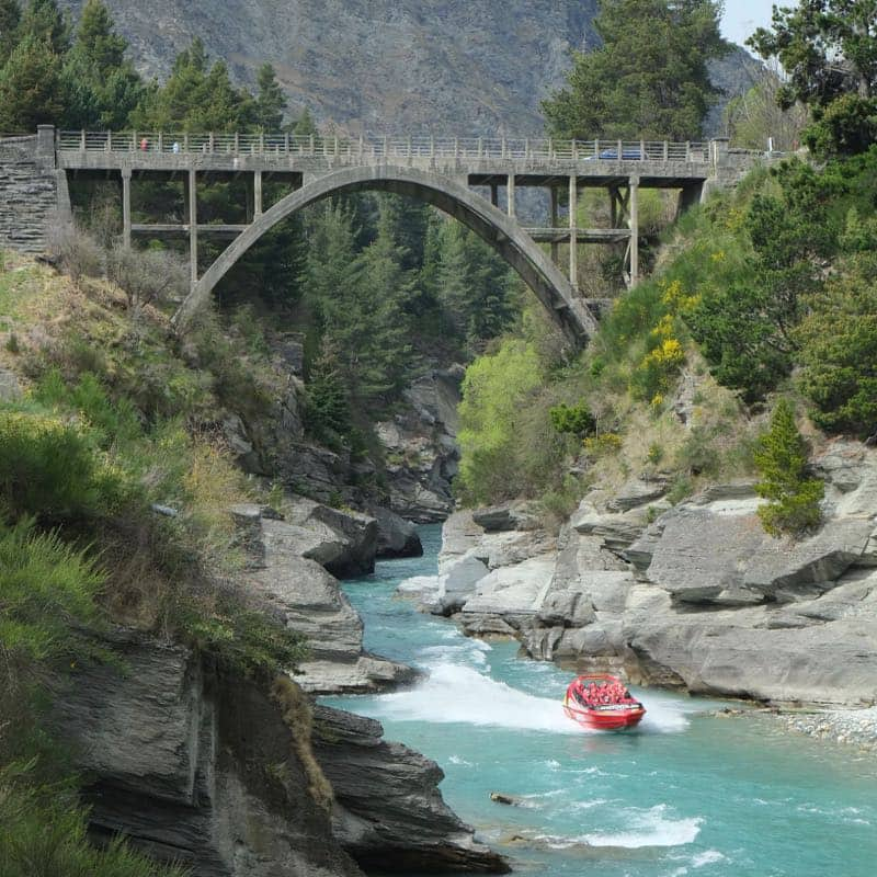 Shotover Jet Boat racing along Shotover River Queenstown