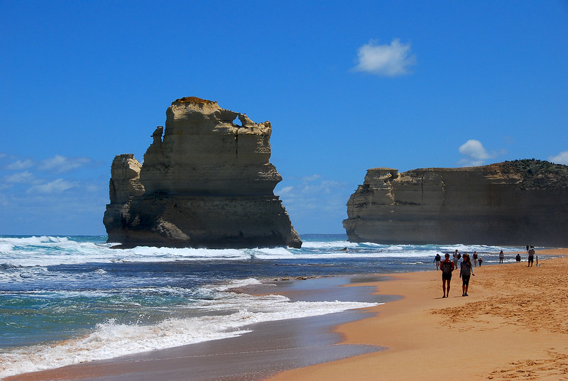 Walking on beach near one of the Twelve Apostles