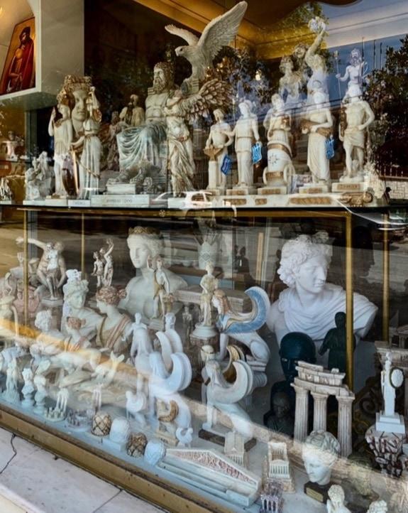 Apollo in tourist shop window Delphi