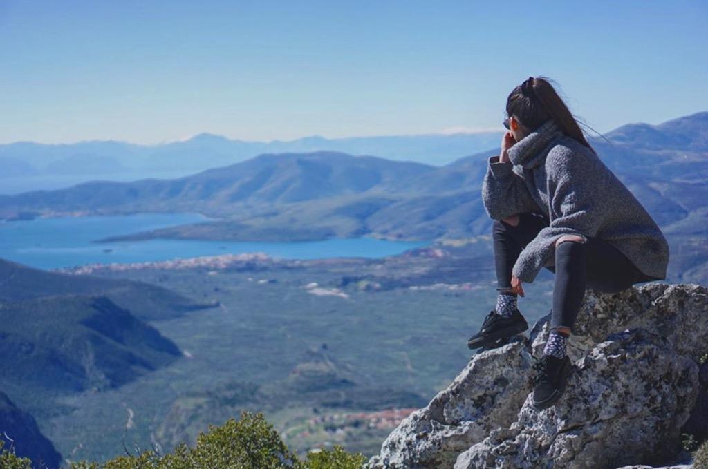 Sitting on a mountaintop in Delphi Greece