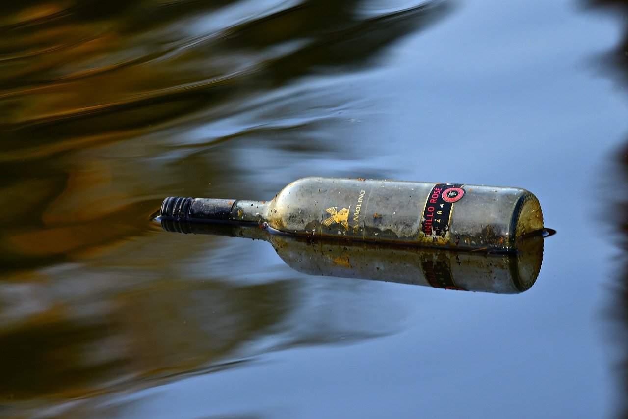 wine bottle floating water