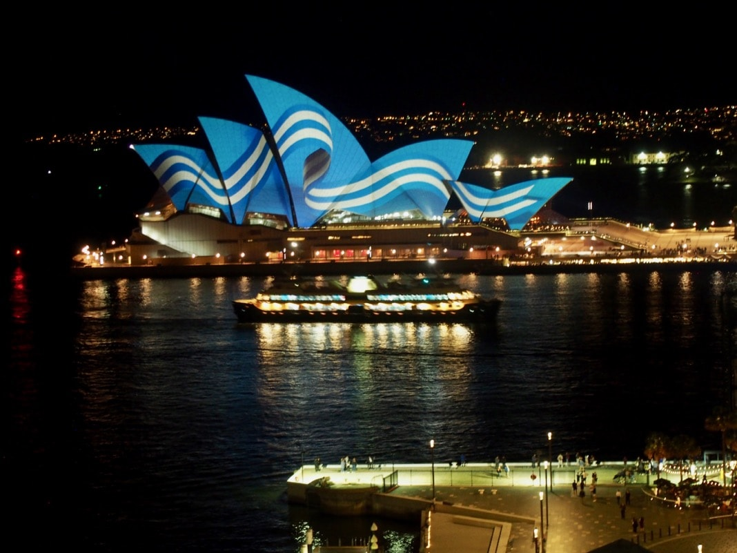 Ferry cruising past Sydney Opera House
